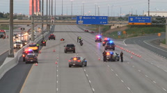 Police near scene on highway Stock Footage