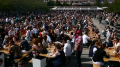 Extreme long shot of crowd of people eating food drinking beer, beverage market Stock Footage