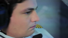 Close-up of concentrated pilot waiting for takeoff permit with serious face Stock Footage