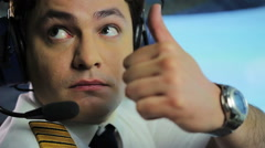 Responsible pilot making thumbs up sign after checking readiness for flight Stock Footage