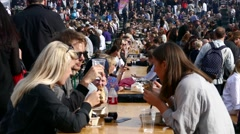 Crowd of people eating food drinking beer, beverage during stockholm food market Stock Footage