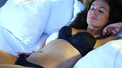 Lingerie girl on bed in the morning - steadicam shot - stock footage