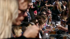 Crowd of people eating food drinking beer, beverage during stockholm food market Arkistovideo
