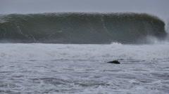 Big ocean sea waves crashing on coastal rocks during storm - stock footage