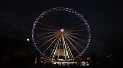 Illuminated roue de Paris at night in Paris Stock Footage