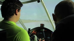 Teacher and beginner student training on flight simulator at aviation school Stock Footage