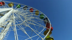 Large carousel at an amusement park. A great wheel turns slowly. Stock Footage