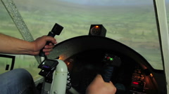 Hands of man holding steering wheel in aircraft simulator, maneuvering flight Stock Footage