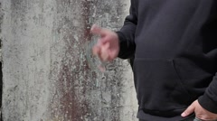 Man playing with handcuffs - stock footage