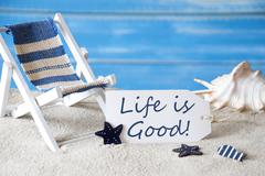 Summer Label With Deck Chair And Quote Life Is Good - stock photo