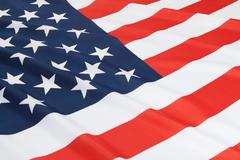 Close up shot of ruffled national flags series - United States Stock Photos
