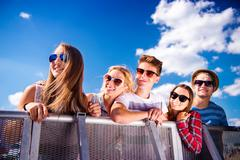 Teenagers at summer music festival, at the barrier - stock photo