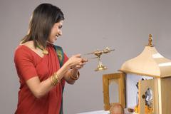 Woman offering prayers Stock Photos