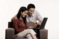 Couple with a laptop Stock Photos
