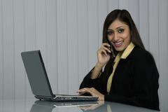 Woman Executive at work Stock Photos