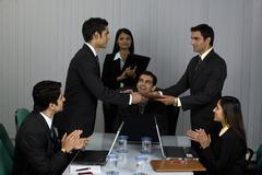 Executive handing a file Stock Photos