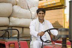 A farmer on his tractor Stock Photos