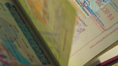 Inside of passport with stamps, and visas thailand, seychells, maldives Stock Footage