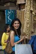 Girls at a garment shop Stock Photos