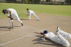 Cricketers in action Stock Photos