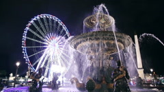 Fountain avant roue de paris at night in Paris Stock Footage