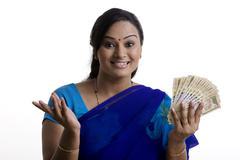 Woman with money Stock Photos