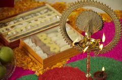 Diya and sweets Stock Photos