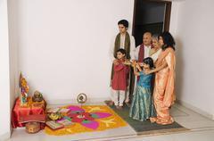 Family performing a pooja Stock Photos
