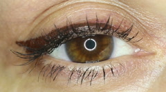 Female brown eye close-up Stock Footage