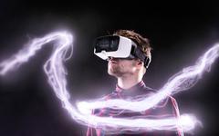 Man wearing virtual reality goggles. Studio shot, black backgrou Stock Photos