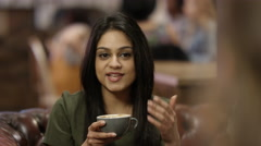 4KBeautiful Asian girl chatting & having drinks with friends in city coffee shop Stock Footage
