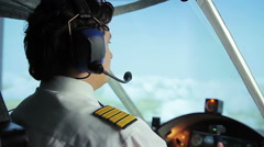Airliner crew commander navigating plane in blue sky, passenger transportation Stock Footage