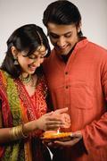 Couple holding Diya Stock Photos