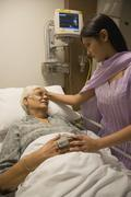 A relative visiting a patient Stock Photos