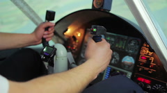 Hands of male pilot turning steering wheel, switching controls on cockpit panel Stock Footage