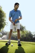 Golfer about to make a strike Stock Photos