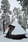 Snowy hut in Lapland, Finland. - stock photo