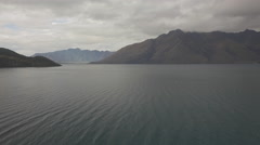 Aerial Pan of Cloudy Lake Stock Footage