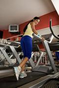 Woman on the treadmill Stock Photos