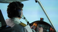 Worried pilot talking to air traffic controller, asking for landing permit Stock Footage