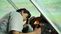 Unconscious or dead pilot lying on steering wheel, aircraft flying uncontrolled Stock Footage