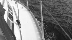 Sailing yacht sailing close up of water streaming past side - stock footage