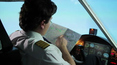 Unreliable airline pilot wearing captain uniform lost direction, checking map Stock Footage