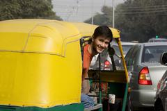 Man looking out of an auto rickshaw Stock Photos