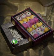 Box of sweets and nuts with a diya Stock Photos