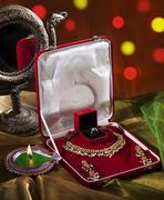 Jewelery set and diya Stock Photos