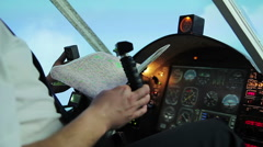 Pilot navigating aircraft with steering wheel, checking flight route on map Stock Footage