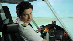 Happy pilot smiling at camera, thumbs up sign, successful career in aviation Stock Footage