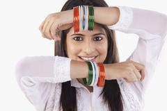 Woman with bangles Stock Photos