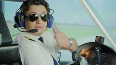 Professional aviator making thumbs up sign for camera, reliable airline services Stock Footage